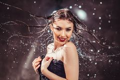 Sexy Wet Girl. Sexy wet brunette girl wears black top under rain splashes Stock Photography