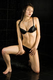 Sexy wet girl in black swimsuit Royalty Free Stock Images