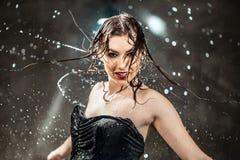 Sexy Wet Girl. Sexy wet brunette girl wears black top under rain splashes Royalty Free Stock Photos