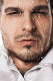 Sexy wet man with flowing water Royalty Free Stock Photography
