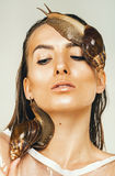 Sexy wet woman with snails on face and neck Royalty Free Stock Photography