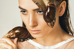 Sexy wet woman with two snails on face Stock Photo