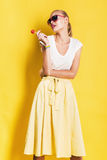 Sexy wet woman in yellow skirt with lollipop Royalty Free Stock Photography