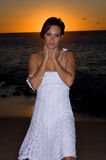 Sexy in a white dress. Sexy girl at sunset in a white dress Royalty Free Stock Image
