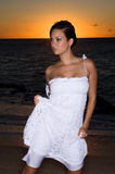 Sexy in a white dress. Sexy girl at sunset in a white dress Stock Images