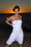 Sexy in a white dress. Sexy girl at sunset in a white dress Royalty Free Stock Photo