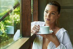 white shirt window, looking, out coffee tea cup view beauti Royalty Free Stock Image
