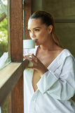 Sexy white shirt window looking out coffee tea cup view beauti Stock Photos