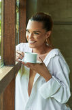 Sexy white shirt window, looking, out coffee tea cup view beauti Royalty Free Stock Image
