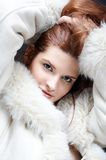 Winter girl. Girl in fur coat stock image