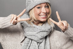 Sexy winter girl agreeing twice with double victory signs Royalty Free Stock Photos