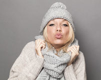 Sexy winter woman expressing tenderness in pouting and kissing signs Royalty Free Stock Image