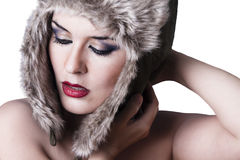 Sexy winter woman with snow hat, isolated on white Royalty Free Stock Photo