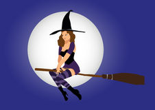 Sexy witch. Flying on broom Royalty Free Stock Photo