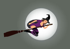 Sexy witch. Flying on broom Royalty Free Stock Image