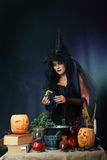 Sexy witch on a dark background Royalty Free Stock Photos