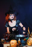 Sexy witch on a dark background Stock Photography