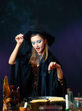 Sexy witch on a dark background Royalty Free Stock Image