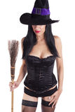 Sexy witch and her broomstick. Royalty Free Stock Images