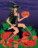 Sexy witch with a knife and a pumpkin Stock Photo