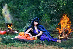 Sexy witch near a fire Royalty Free Stock Photo
