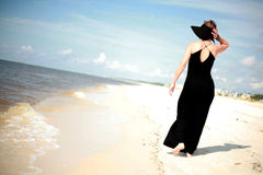 Sexy Woman. A sexy woman wearing a long black dress at the beach Royalty Free Stock Photos
