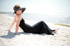 Woman. A woman relaxing at the beach royalty free stock images