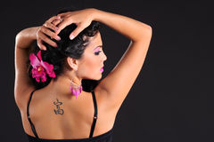 Woman. Brunette with tattoo on her back royalty free stock images