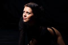 Sexy woman. Lying in aqua studio. Black background Royalty Free Stock Photo
