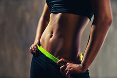Woman abdominal muscles. Young sports woman abdominal muscles royalty free stock photos