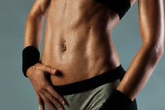 Sexy woman abdominal muscles Royalty Free Stock Image