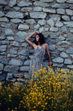 Woman Against Old Stone Wall Royalty Free Stock Photos