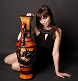 Sexy woman with amphora Stock Images