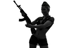 Sexy woman in army uniform holding kalachnikov silhouette Royalty Free Stock Image