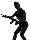 Sexy woman in army uniform holding kalachnikov silhouette Stock Photos