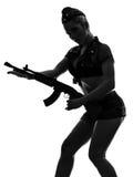 Sexy woman in army uniform holding kalachnikov silhouette. One  sexy woman in army uniform holding kalachnikov in silhouette studio isolated on white background Stock Photos