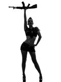 Sexy woman in army uniform saluting kalachnikov silhouette. One caucasian sexy woman in army uniform saluting with kalachnikov in silhouette studio isolated on Royalty Free Stock Photo