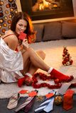 Sexy woman arranging christmas gifts Stock Photos