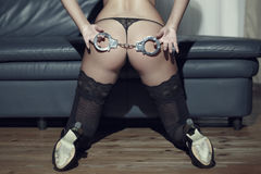 Sexy woman ass with handcuffs Royalty Free Stock Photography