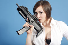 woman with assault gun Stock Images