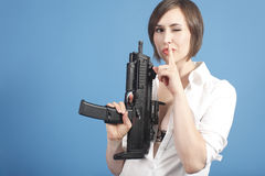 Sexy woman with assault gun Stock Images