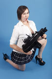 Sexy woman with assault gun Stock Image