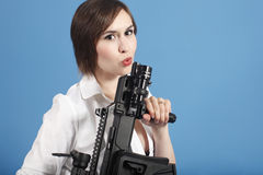 Sexy woman with assault gun Stock Photo
