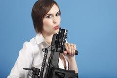 Sexy woman with assault gun Stock Photo