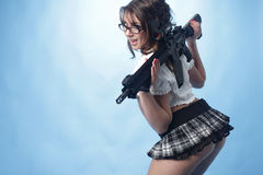 Sexy woman with assault rifle Stock Photography