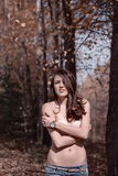 Sexy woman in autumn forest Royalty Free Stock Image