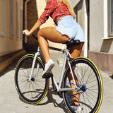 Sexy woman back on a bicycle - close up.  Royalty Free Stock Images