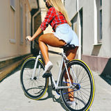 Sexy woman back on sport style fixed gear bicycle outdoor.  Royalty Free Stock Photo