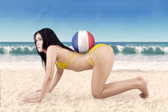 Sexy woman with ball and flag of France at beach Stock Photography
