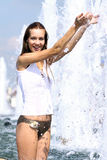 Sexy woman bathes in a city fountain Stock Image